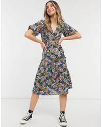 New Look Vestido midi con estampado floral mixto y bajo escalonado - Negro