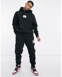 Nike Joggers negros con bajos ajustados Flight