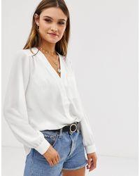 ASOS Blusa de manga larga con detalle de bolsillo en marfil de -Blanco