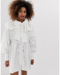 Sister Jane Button Down Mini Smock Dress With Oversized Crochet Bib And Pussybow - White