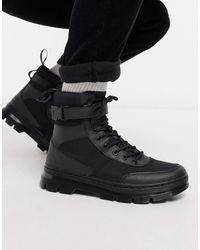 Dr. Martens Combs Tech - Laarzen Met 8 Veteroogjes - Zwart