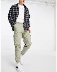 New Look Pantaloni cargo kaki con fondo elasticizzato - Verde