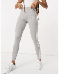 adidas Originals Adicolor - Leggings grigi con logo con tre strisce - Grigio