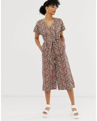 Monki Jumpsuit With Tie Waist And Button Detail In Red Floral Print