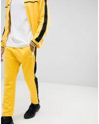 DIESEL Two-piece P-ska Side Stripe Sweatpants In Yellow
