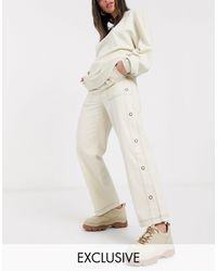 Collusion Pantaloni con cuciture a contrasto e bottoni a pressione laterali - Bianco