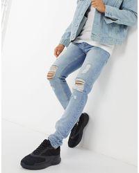 Criminal Damage – Uzi – Schmal geschnittene Jeans - Blau