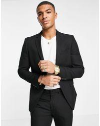 TOPMAN Pantaloni da abito skinny nero testurizzato