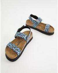 Birkenstock Sandales plates motif léopard avec bride arrière - Bleu