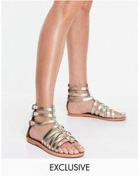 Schuh Tauras Leather Gladiator Sandals - Metallic