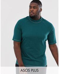 ASOS Plus - T-shirt col montant à manches raglan en jersey contrastant avec surpiqûres contrastantes - Vert