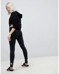 adidas Originals Adicolor Trefoil leggings In Black