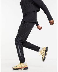 The North Face Joggers negros con puños ajustados y logo Train N