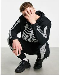 ASOS Felpa con cappuccio nera oversize con stampa con scheletro per Halloween - Nero