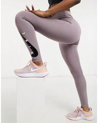 Nike Leggings a sette ottavi viola con logo Nike