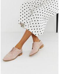 87bedfdbff2 Zapatos brogues con suela de dientes Dr. Martens de color Rosa - Lyst