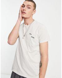 Religion Camiseta color marfil con bolsillo - Multicolor