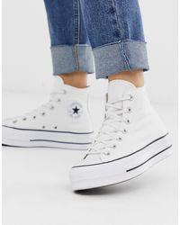 Converse Chuck Taylor All Star - Sneakers alte bianche con logo oversize - Bianco
