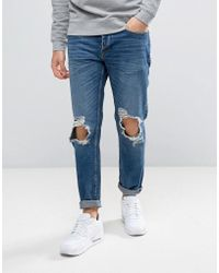 River Island - Slim Fit Tapered Jeans With Rips In Dark Wash - Lyst