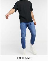Reclaimed (vintage) – Inspired – Schmal zulaufende 89er-Jeans - Blau