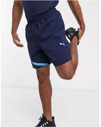 PUMA Pantalones cortos para correr en azul marino exclusivos en ASOS