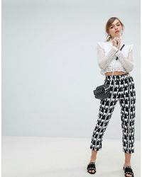 Sister Jane Cigarette Pants With Front Stripe In All Over Llama Print - Black
