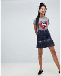Love Moschino - Minigonna di jeans ricamata con volant - Lyst