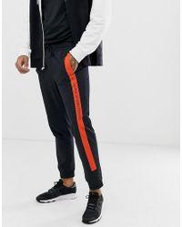 Calvin Klein Joggers con rayas y logo - Negro