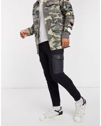 The Couture Club Contrast Pocket Tapered Cargo Trackies - Black