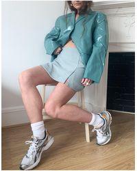Weekday Jules - mini-jupe fendue d'ensemble à motif pied-de-poule - Bleu