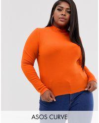 ASOS - ASOS DESIGN Curve - Crop top côtelé col roulé à manches longues avec bord brut - Orange - Lyst