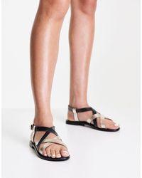 Vero Moda Sandales plates en cuir à brides croisées - Noir - Métallisé