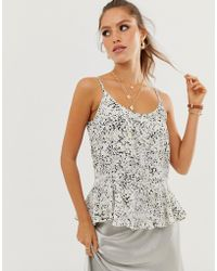 River Island Cami Top With Peplum Hem In Ditsy Floral Print - Black
