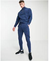 ASOS Tuta sportiva oversize blu con felpa con zip corta e joggers skinny