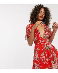 Missguided – Tief ausgeschnittener, kurzer Jumpsuit mit floralem Print - Rot