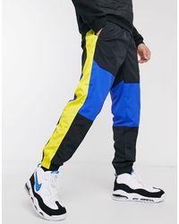 Nike - Re-Issue - Joggers nero/blu con fondo elasticizzato - Lyst