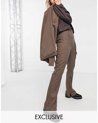 Collusion Pantaloni a zampa marroni a quadretti con zip sul fondo - Marrone