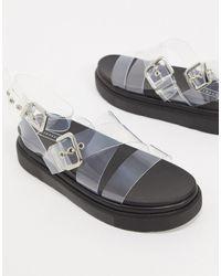TOPSHOP – Flache Sandalen mit transparenten Riemen und Schnallen - Mehrfarbig