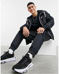 Nike – Gewebter Trainingsanzug mit Kapuzenpullover mit Reißverschluss - Schwarz