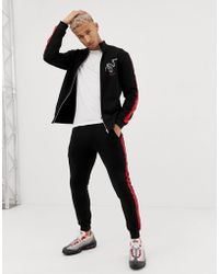 ASOS Tracksuit Track Jacket/skinny joggers With Snake Print And Side Stripe - Black