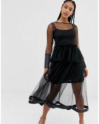 Amy Lynn Vestido de corte recto transparente de manga larga - Negro