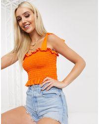 Boohoo Esclusiva - Top basic increspato arancione corto con spalline annodate