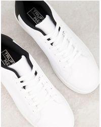 Truffle Collection Sneakers stringate bianche con tallone nero - Bianco
