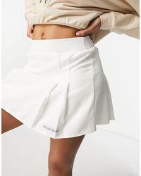 Public Desire Mini-jupe plissée - Blanc