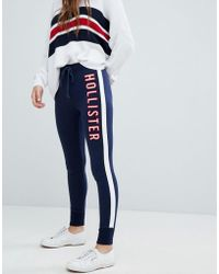 Hollister - Logo Skinny Track Pant With Stripe - Lyst