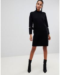 Liquorish - Long Sweater Dress With Front Pockets And Lacing Detail On Sleeves - Lyst