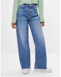 Bershka – Jeans mit weitem Bein im Stil der 90er-Jahre - Blau