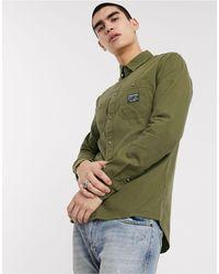 Tommy Hilfiger – Surplus – Olivgrünes Utility-Hemd