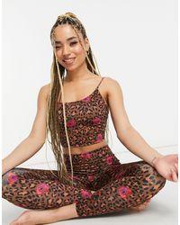 Onzie Bella - Top da yoga a canottiera con supporto leggero e stampa a fiori leopardata - Multicolore