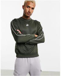 Nike – Repeat Pack – Khakifarbenes Polyknit-Sweatshirt mit Rundhalsausschnitt und Logostreifen - Mehrfarbig